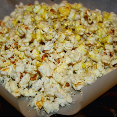 Popcorn with Grated Asiago, Cracked Black Pepper,  and UP Certified Wild Mushroom-Sage Olive Oil